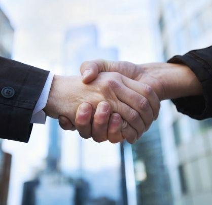 hands shaking representing partnership