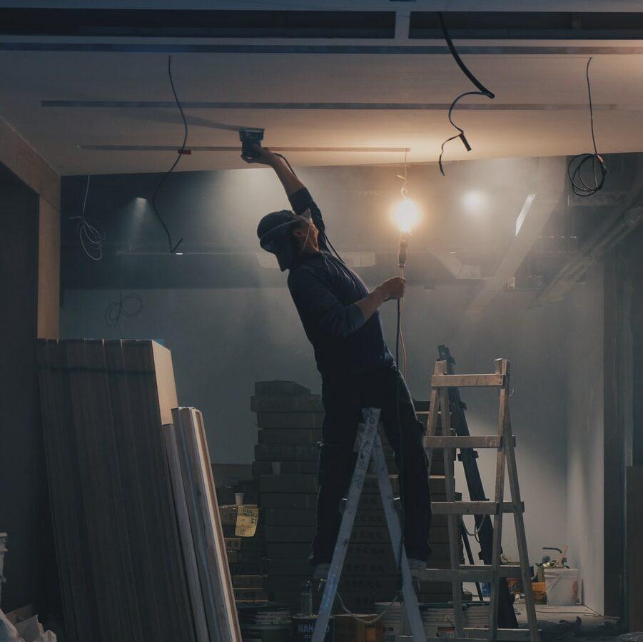 man doing construction work to open a cannabis dispensary
