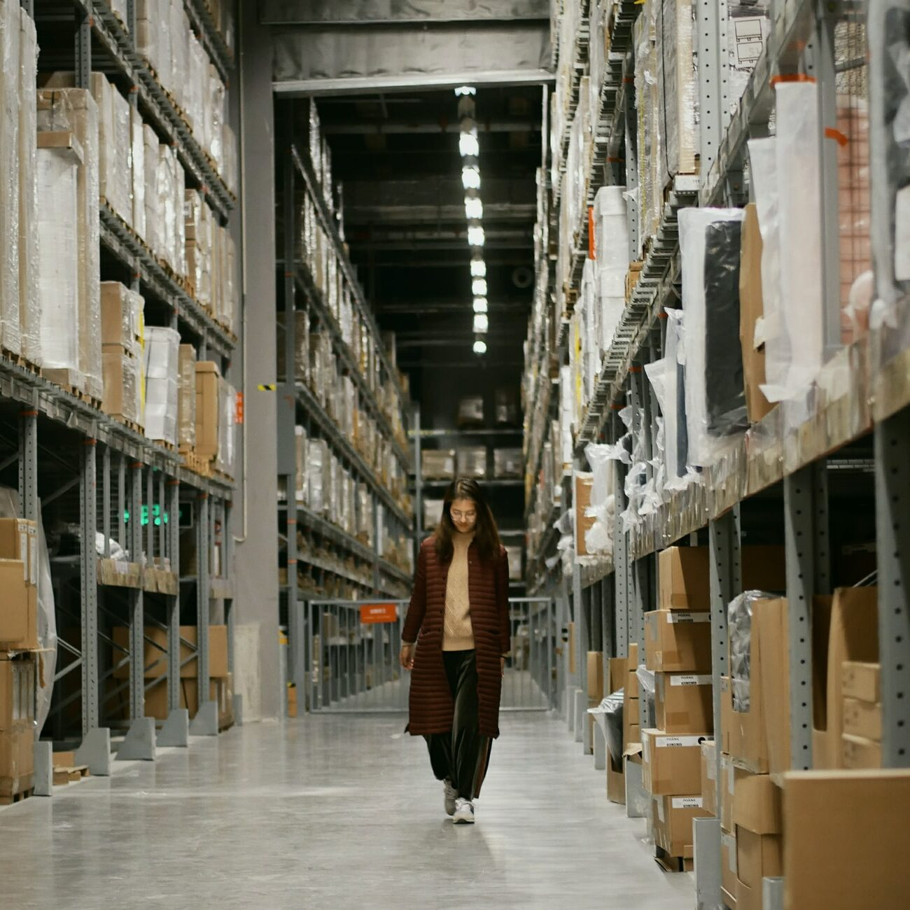 woman walking in a cannabis distribution warehouse at night