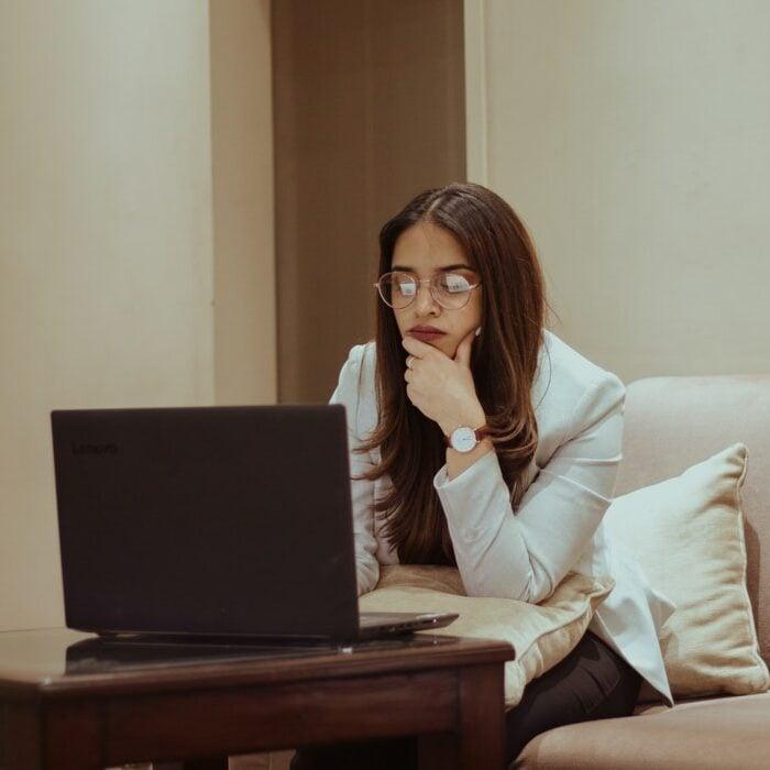 female cannabis executive on a laptop